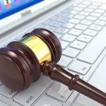 Online judgement. Gavel on laptop. Conceptual image. 3d